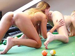 Неугомонные подружки ласкают киски на бильярдном столе